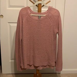 a pink sweater
